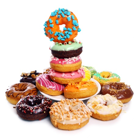 Colorful and tasty donuts on white background Stock Photo - 9000270