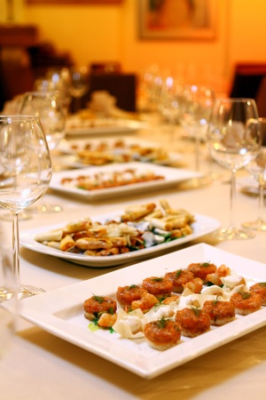 Banquet table with restaurant serving and snacks Stock Photo - 9070820
