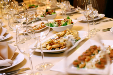 Banquet table with restaurant serving and snacks Stock Photo - 9070843