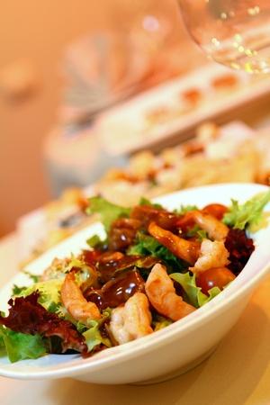 Fresh salad on banquet table at restaurant photo