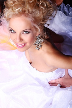 Young and beautiful bride in luxury wedding dress photo