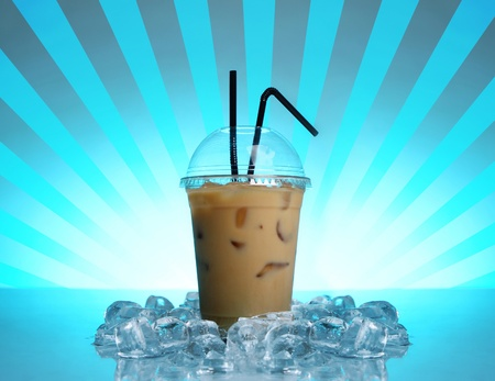 Cold coffee drink on abstract blue background photo