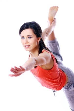 Young and beutiful woman doing yoga exercises photo
