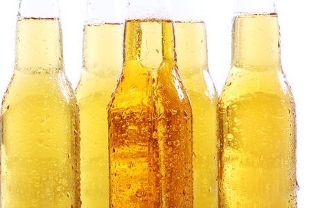 Bottles of cold and fresh beer. Close up view. photo