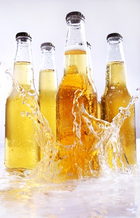 Beer bottles with water splash photo