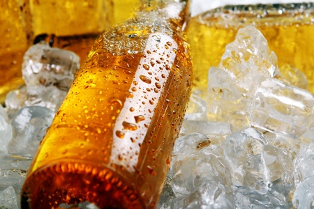 Bottles of cold beer lying in the ice. Close view. photo
