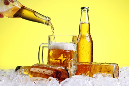 single beer bottle: Beer is pouring into glass