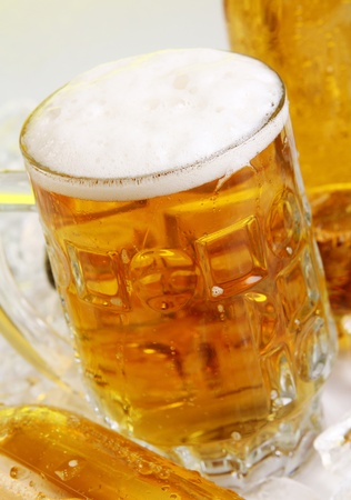 Bottles and Glass of beer with foam Stock Photo - 9636298