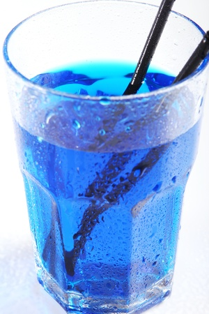 Wet Glass with blue cocktail photo