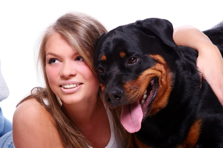brown and black dog face: Beautiful girl with her cute dog on white