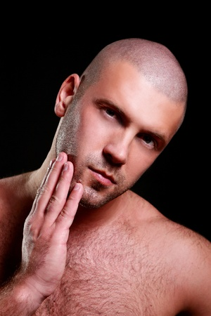 Young and beautiful men touching his own beard Stock Photo - 9796694