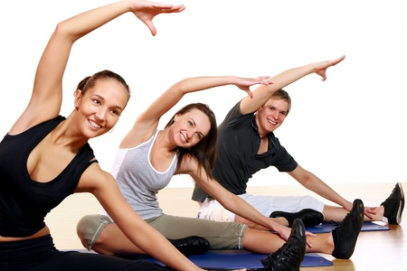 exercise: Group of People Doing Fitness Exercises in Gym
