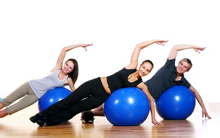 Group of People Doing Fitness Exercises in Gym Stock Photo - 9824520