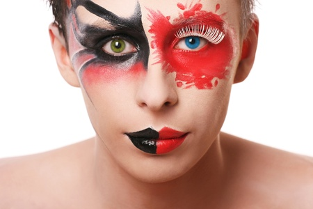 Beautiful man with abstract make up and different color in his eyes photo