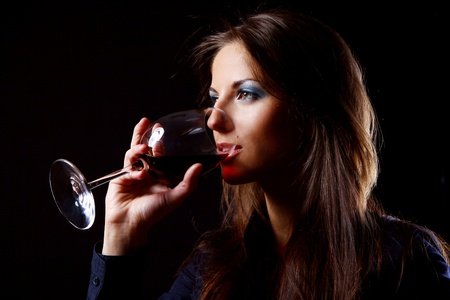 Young and Beautiful girl with glass of wine photo