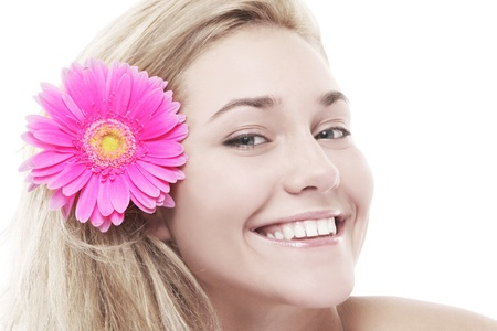 Beautiful woman with pink flower in her hairs isolated over white background photo