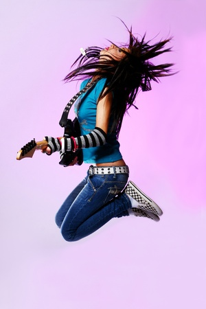 Beautiful Emo Girl Jumping with guitar photo