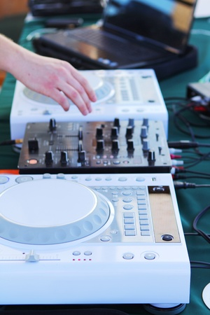 Different DJs equipment on the table photo