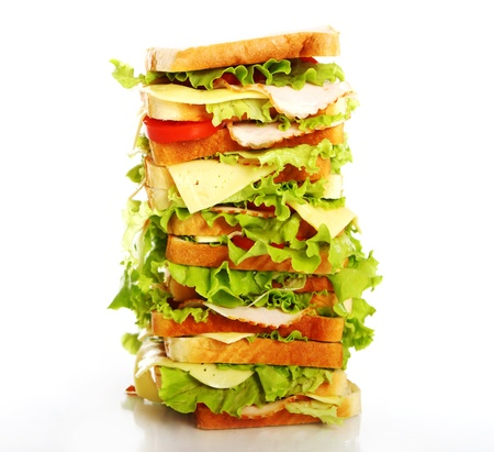 Very big sandwich isolated over white background photo