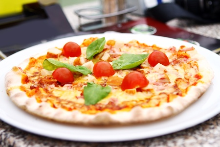 Hot and tasty pizza on the plate Stock Photo - 10053877