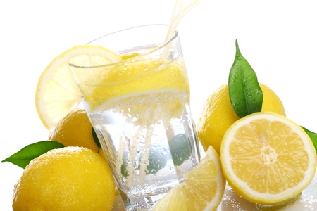 water reflection: Cocktail with fresh wet lemons on white background Stock Photo