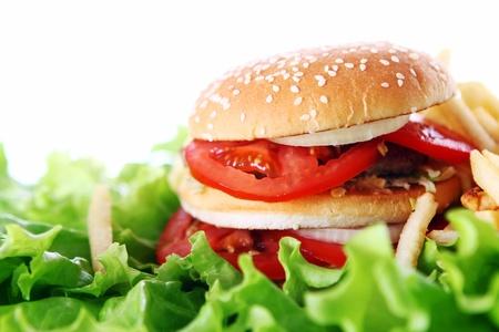 Big and tasty burger on the salad leaves photo