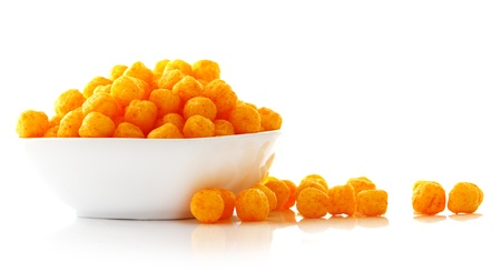 crunchy: Cheese balls in the bowl isolated over white background