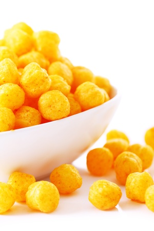 Cheese balls in the bowl isolated over white background
