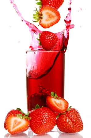 juicy: Strawberry falling into the glass with drink and makes big splashes Stock Photo