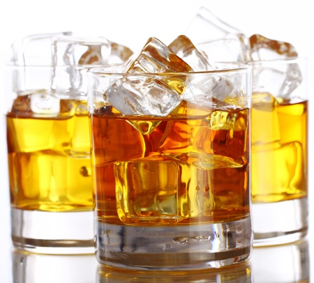 Glasses of cold whiskey with ice isolated over white Stock Photo