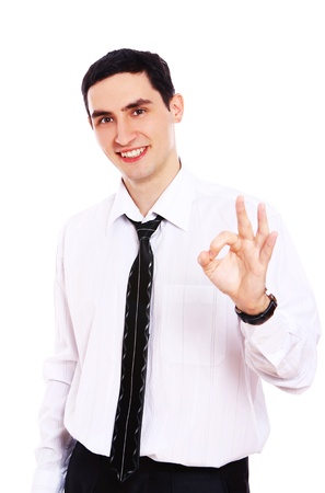 Young smiling businessman showing OK sign isolated over white photo