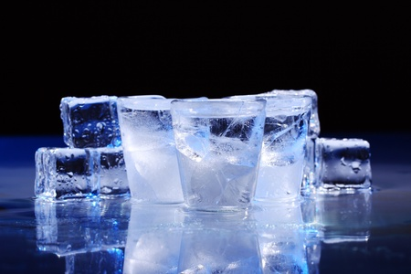 Frozen glasses and ice cubes with cold alcohol drink Stock Photo - 10279815