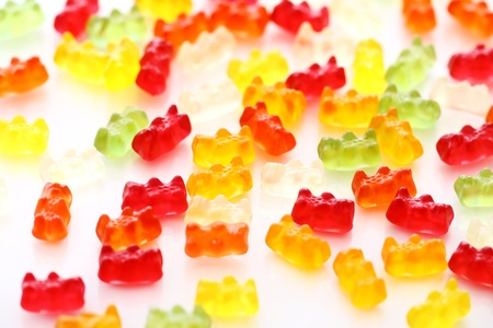 Colorful gummy bear candies over white background photo