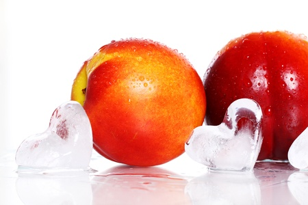 Fresh and wet nictarine fruits isolated over white Stock Photo - 10279803