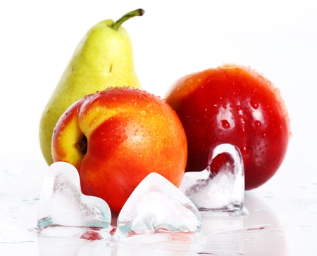 Fresh and wet fruits and ice isolated over white Stock Photo - 10279839