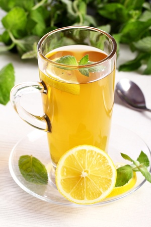 Cup of hot  tea with mint and lemon photo