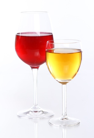 Glasses with fruit wine with reflection photo