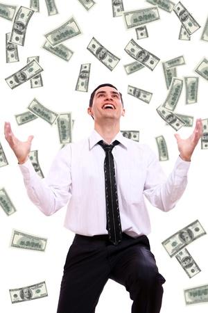 loteria: Hombre de negocios feliz y volar billetes de d�lares contra el fondo blanco