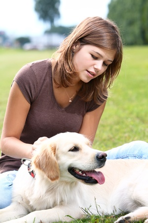 Woman playing with her dog outdoors Stock Photo - 10576189