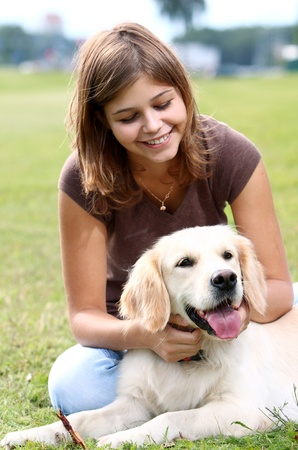 Woman playing with her dog outdoors Stock Photo - 10576187