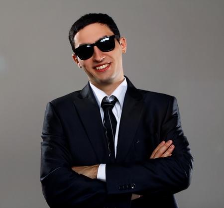 Smiling businessman in sunglasses photo