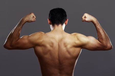 Young muscular guy shows his strong back Stock Photo - 10504902