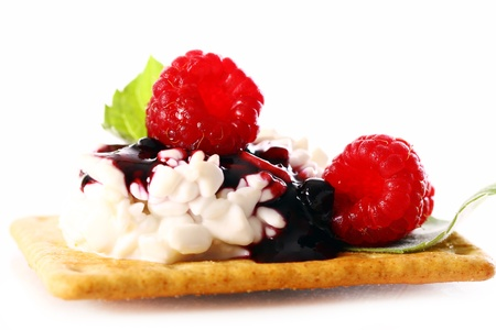Dessert with raspberry and cottage cheese over white background photo