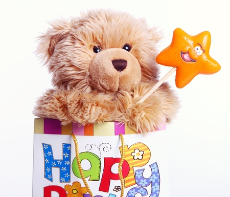 Cute Teddy Bear with lollipop in the gift bag Stock Photo - 10556724