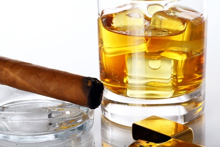 Glass of Whiskey and Cigar against white background photo