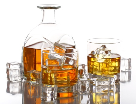 Glasses of cold whiskey with ice isolated over white photo