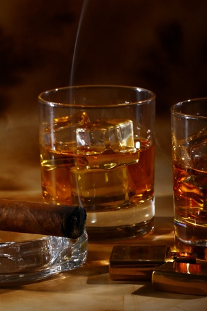 ashtray: Cold whiskey  and cigar against ancient background