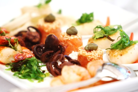 Seafood snack with octopus on banquet table photo