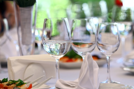 food buffet: Wine glasses on luxury banquet table