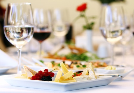 Different tasty snacks for wine on luxury banquet table photo